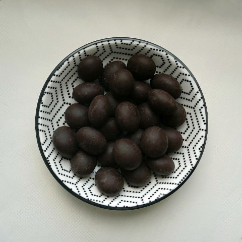 Bowl of chocolate coated coffee beans photo by Ji Elle