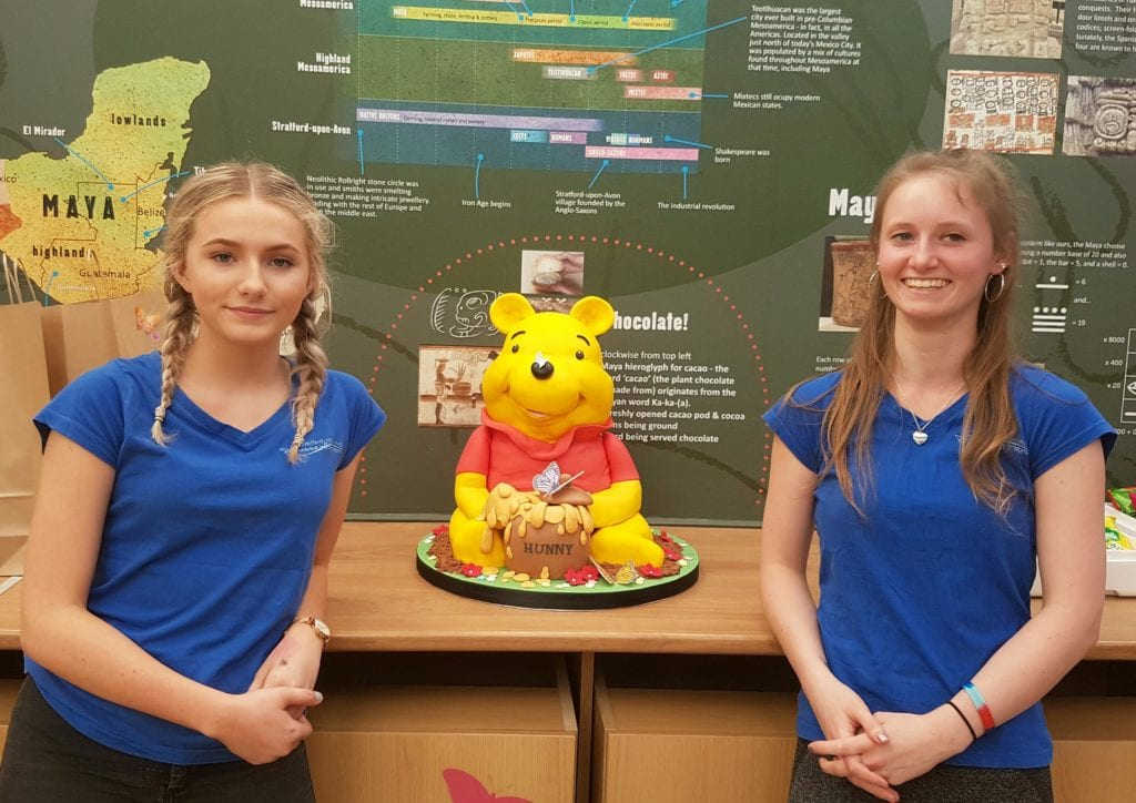 Jess Revell and Faith Bailey from The Stratford Butterfly Farm with the donated cake