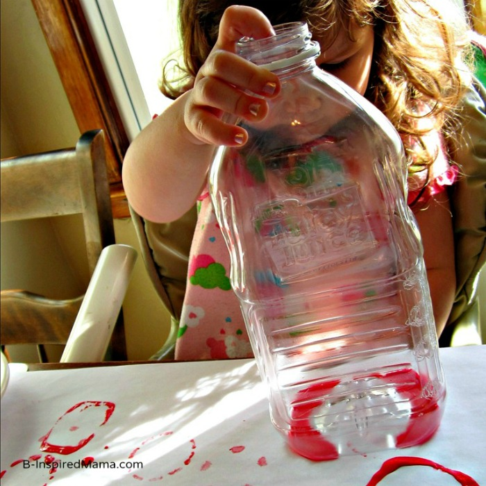 Exploring Shapes with Plastic Bottle Print Painting at B-InspiredMama.com