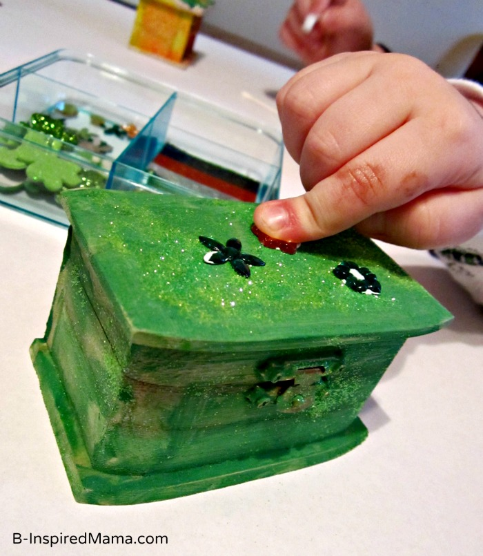 Kid Gluing their St. Patrick Craft Leprechaun Trap Box at B-InspiredMama.com
