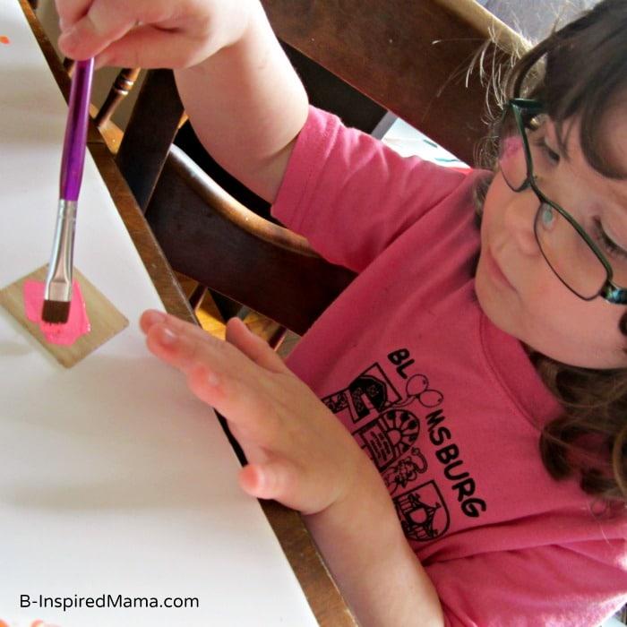 Priscilla Making Kids Fingerprint Magnets for Mother's Day at B-InspiredMama.com