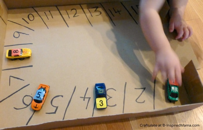 Playing with a Car Parking Numbers Game - Craftulate at B-InspiredMama.com