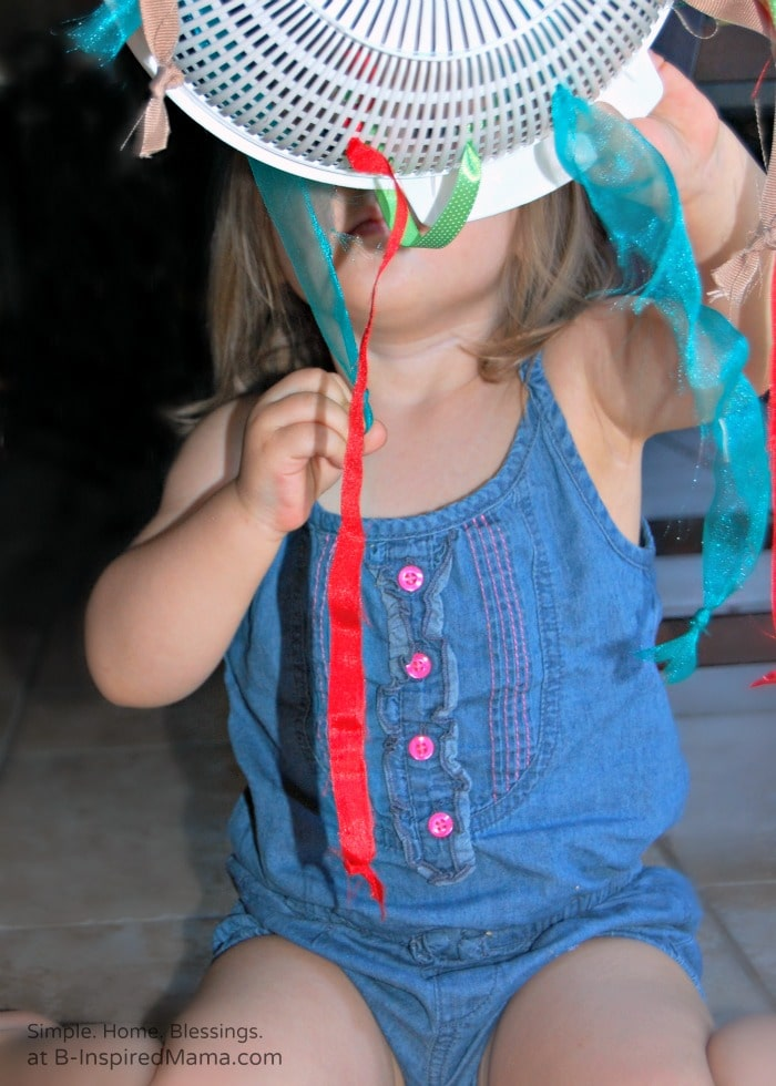 A Little Girl Playing with a Simple DIY Toy at B-Inspired Mama