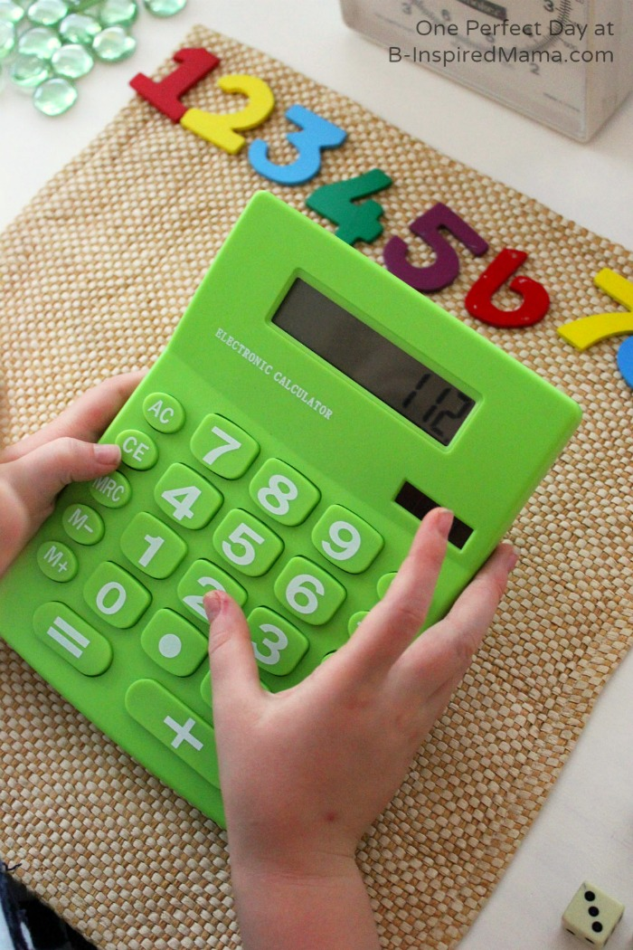 Using a Calculator and Loose Parts for Math Fun at B-Inspired Mama