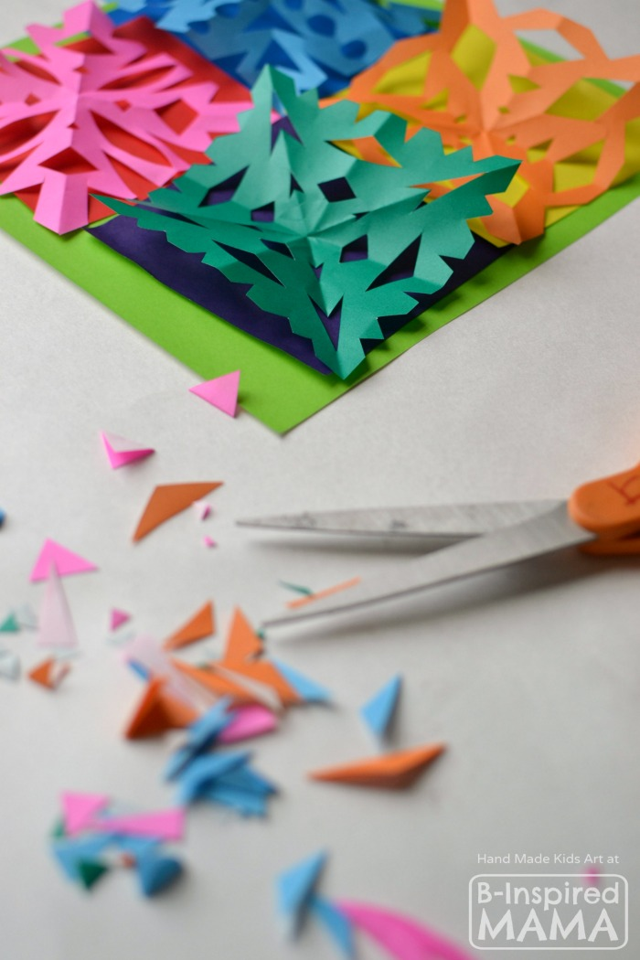 Making a Colorful Kids Art Quilt using Paper Snowflakes - B-Inspired Mama