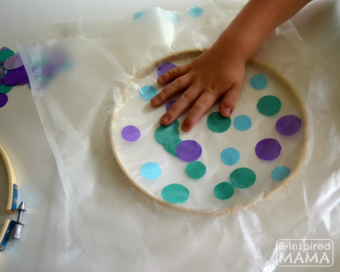 A Simple Circles Suncatcher Summer Craft - Pressing the Suncatcher Collage - B-Inspired Mama