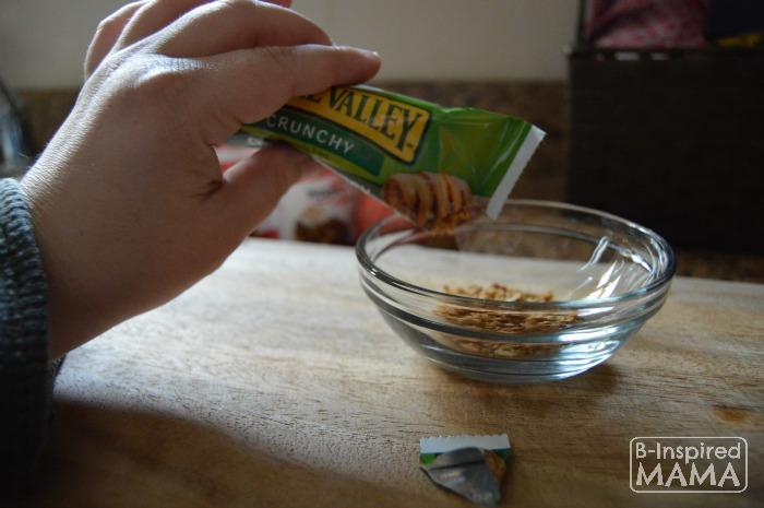 Easy No Bake Apple Crisp Snack - Adding the Crushed Granola Bar - B-Inspired Mama