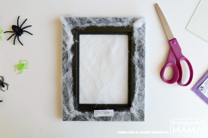 Spider Web Picture Frame Halloween Craft - Adding the Spider Web 2 - B-Inspired Mama