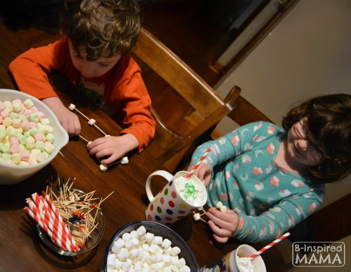 JC and Priscilla Making Marshmallow Sculptures while they Enjoy their Hot Chocolate - at B-Inspired Mama