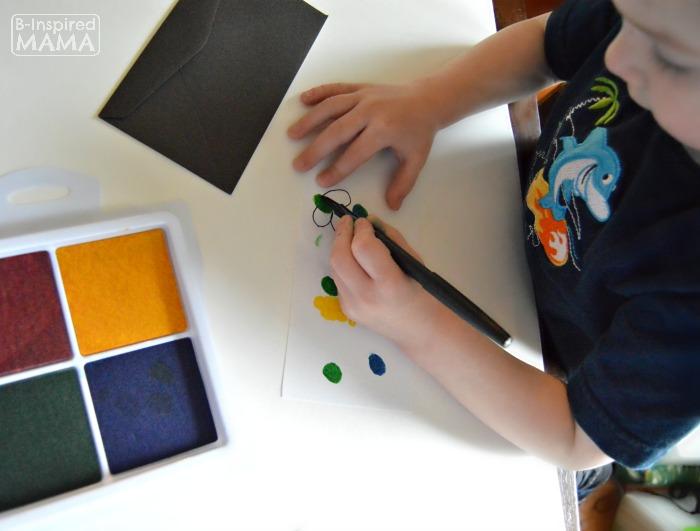Fingerprint Flowers - Sweet Handmade Mother's Day Cards for Kids - Adding Line Details - at B-Inspired Mama