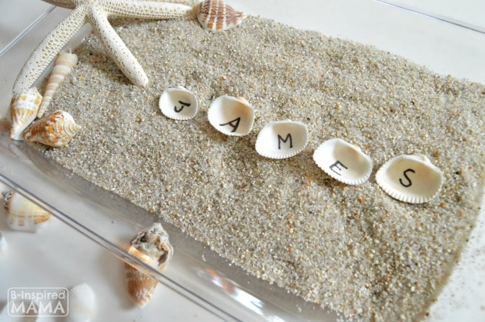 Learning the Alphabet with Seashells and Sand Sensory Writing - Learning to Spell His Name - at B-Inspired Mama