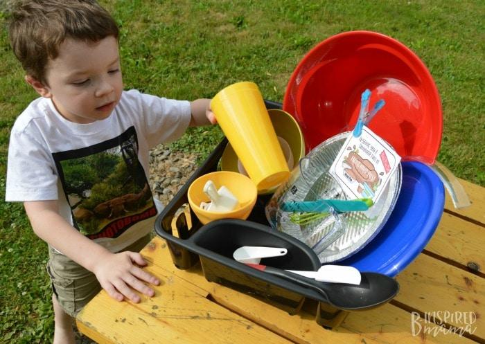 DIY Mud Pie Making Kit + A Free Printable Gift Tag - JC checks out his supplies - at B-Inspired Mama