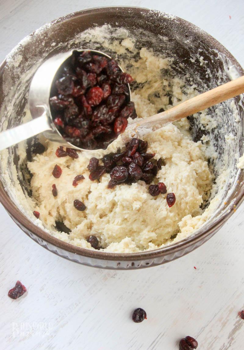 Adding Ocean Spray Craisins Dried Cranberries to Orange Cranberry Muffins
