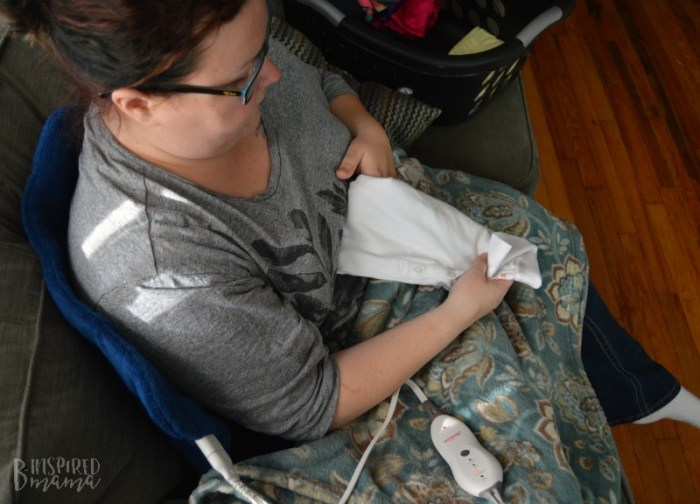 6 Solutions for Busy Moms with Low Back Pain - using my Sunbeam Heating Pad while I fold laundry