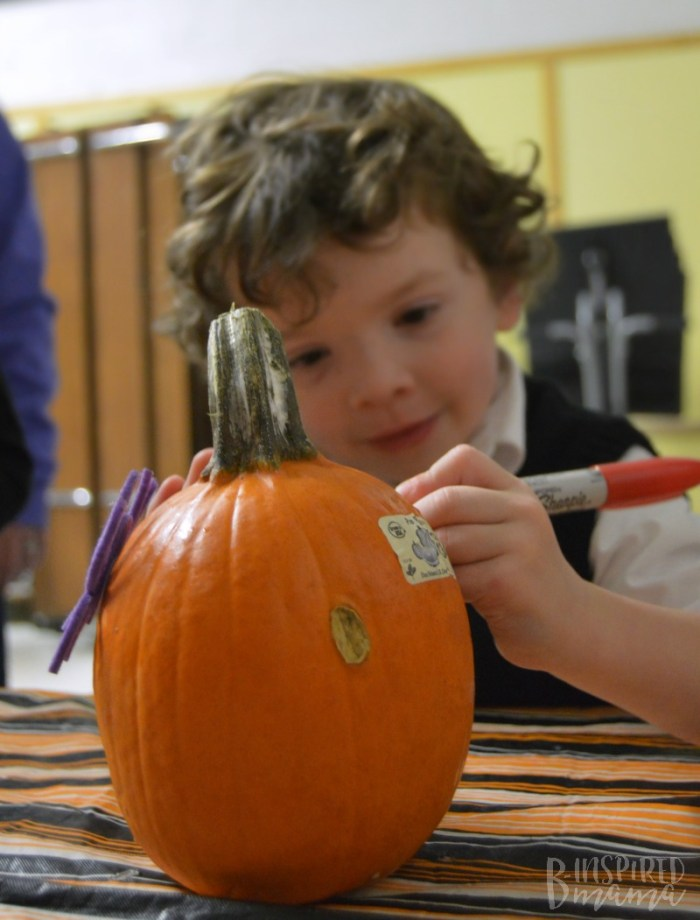 J.C. decorating a pumpkin at the Scouting Harvest Party + Info about the New Lion Cub Scout Program for Kindergarten Boys