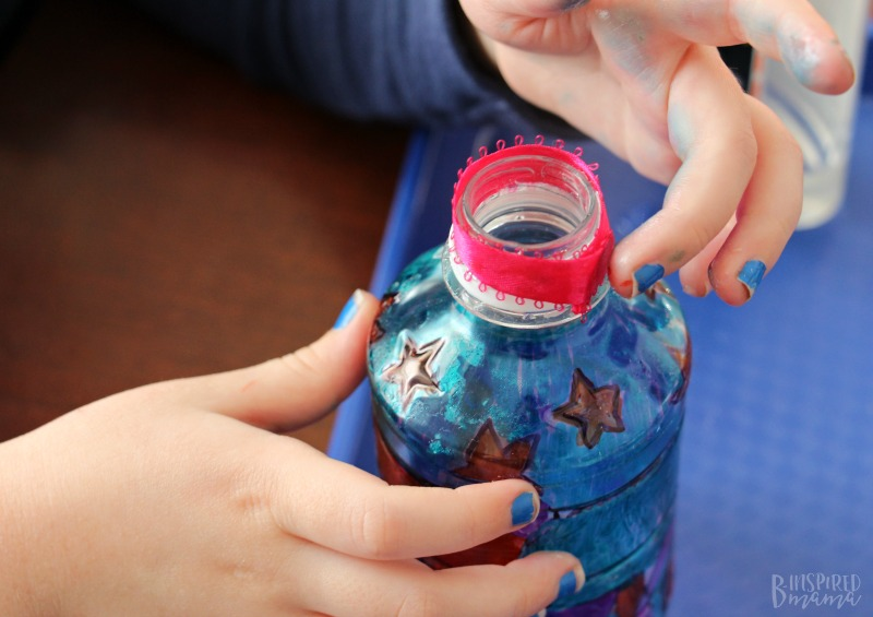 Adding ribbon to our Tum-E Yummies bottle for our Funky Flower Vase Plastic Bottle Craft
