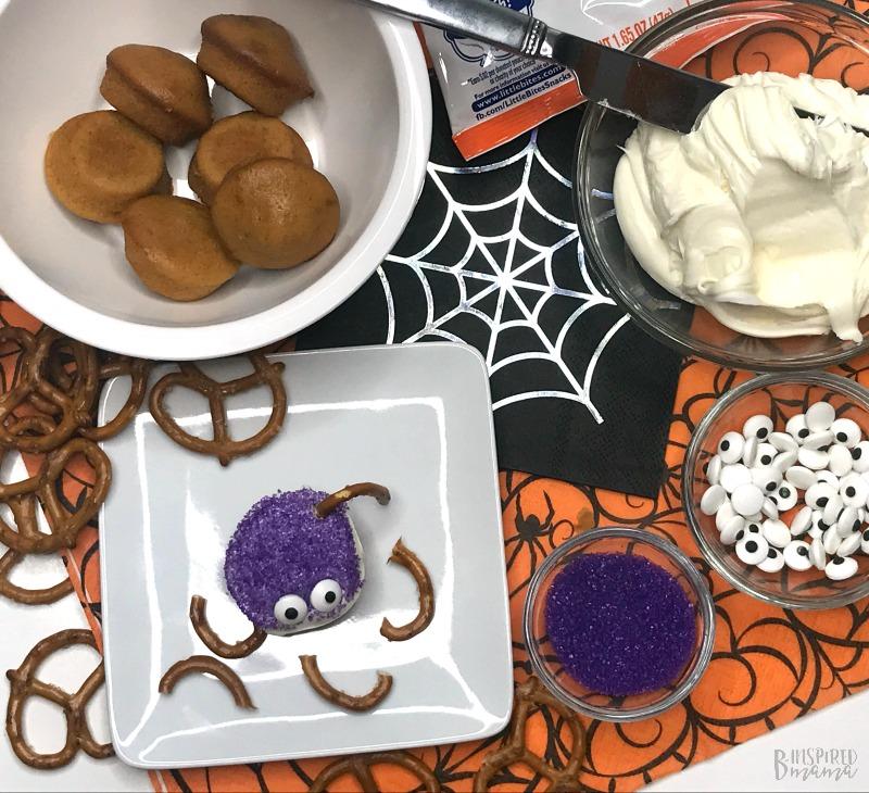 Adding Pretzel Legs - Spider Bites for a fun Halloween Snack for Kids