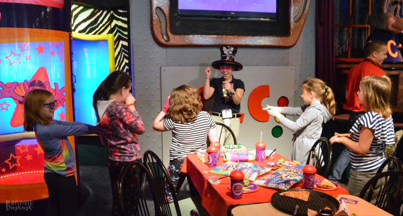 Dancing with our Party Host at Chuck E. Cheese's + Birthday Traditions for Kids that are Meaningful but EASY! - at B-Inspired Mama