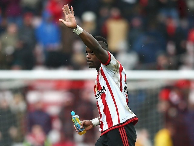 Lamine Kone waves after scoring the match-winner during the Premier League game between Sunderland and Manchester United on February 13, 2016