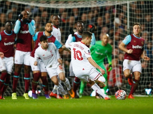 Philippe Coutinho of Liverpool scores their first and equalising goal from a free kick during the FA Cup fourth-round replay against West Ham United on February 9, 2016