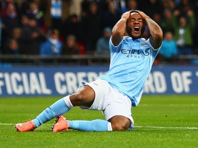 Raheem Sterling clutches his afro after missing a shot during the League Cup final between Liverpool and Manchester City on February 28, 2016