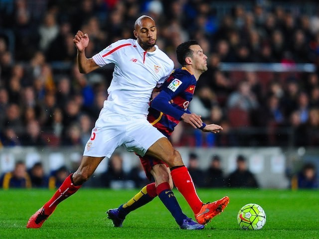 Steven N'Zonzi barges Sergio Busquets during the La Liga game between Barcelona and Sevilla on February 28, 2016