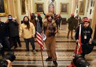 """""""QAnon Shaman"""" who stormed Capitol denies he is antifa as conspiracy theorists turn on him. Sucks when your own turn on you cause they're so brainwashed they don't know what to believe anymore."""