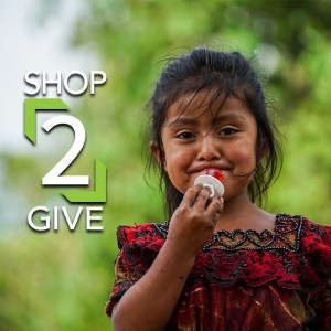 Shop2Give little girl with dark hair eating ring pop