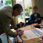 MP Richard Burden signs the 'Rio Declaration' at Northfield Ecocentre's Big Lunch | Image by Richard Burden