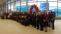Sainsbury's colleagues all ready to great the customers queuing outside the store!