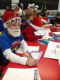 Jervoise School tweeted this photo of pupil Saul, writing Christmas poems - sporting his Christmas jumper and awesome beard!