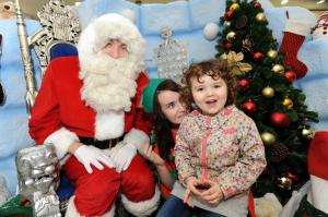 Youngsters queued to meet Santa when he opened the doors of his igloo at Northfield Shopping Centre. The busy shopping centre has been transformed into the North Pole, with animated winter wildlife and Eskimos helping Santa to  greet children Santa with Masie Smith (3) from Rubery