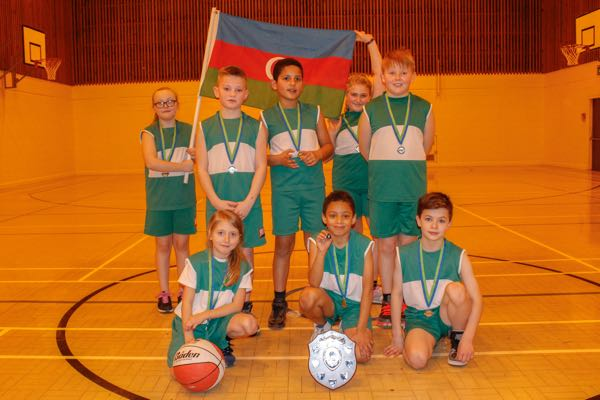 Basketball tournament winners, Hollywood Primary School celebrate their victory at ARK Kings Academy