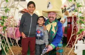 Sameer Khurana, eight, Aryan Khurana, four, of Selly Oak with the Mad Hatter.