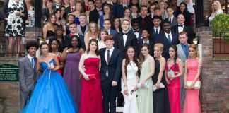 ARK Kings Academy Year 11 class of 2015 pose for a photograph with staff at their leavers' prom 2015
