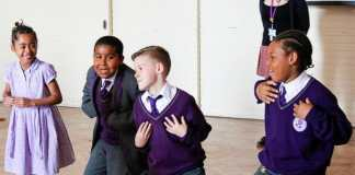 1 girl and 3 boys fom Ark Rose Primary Academy taking part in a creative dance session to build their confidence