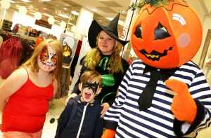 Freya O'Rourke seven and six-year-old Shay O'Rourke meet the centre's Halloween Witch and  Pumpkin Jack