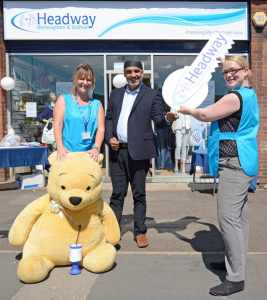 Manny Galsinh gets the key to officially open the new shop with Assistant Shop Manager Sue Wilcox (L) & Shop Manager Rachael Baynham (R)