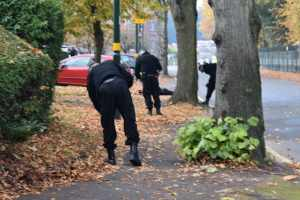 Officers search for evidence at the scene in Raddlebarn Road, close to the junction with Elm Road | Image snappersk