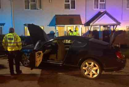The stolen Bentley crashed into the family's cars, causing damage to their home