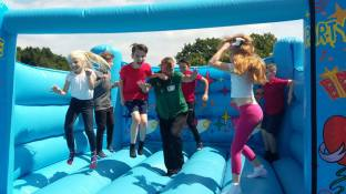 Morrisons Rubery Community Champion Jane Williams 'supervises' the bouncing!