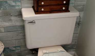 Wallpapering the Toilet Lid