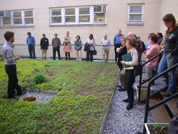 Science teacher Nathaniel Wight leads a tour of Bronx Design & Construction Academy's greenroof. Photo NWF