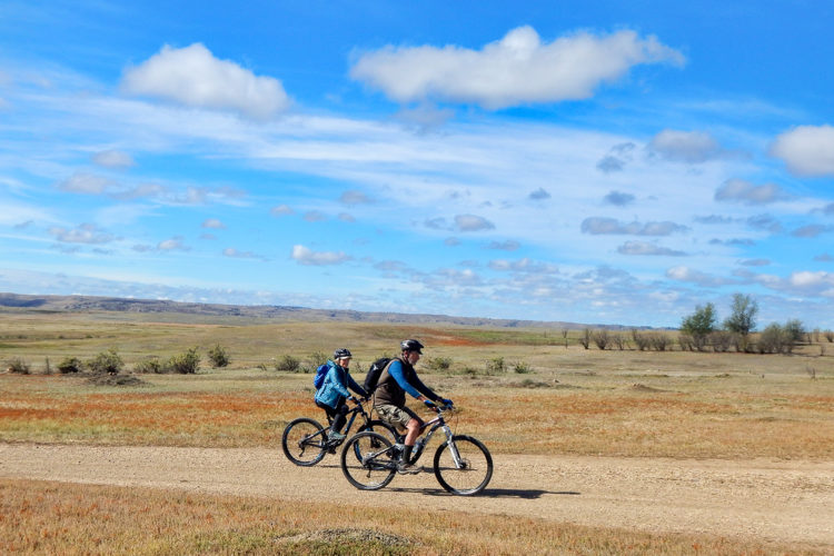 Bruce Wallace and Susie Cannell biked through prairie dog towns and a black-footed ferret recovery area on their 50-mile trek to the American Prairie Reserve. Photo by Steve Woodruff