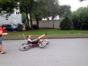 Falling off said recumbent bike.