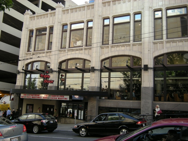 The downstairs space of the Mann Building housed a public market when it was completed in 1926. Kitty corner from the central post office it was called the Postoffice Market. Anderson Food Stores was located within the market. Today This space is the Triple Door Theater. (Photo Joe Mabel on Wikimedia)