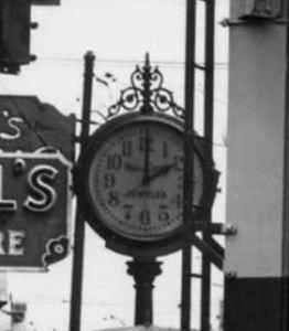Zoom on Thomas Carrolls' clock at 323 Pike St.
