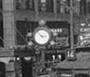 Gus Cohn's clock at 310 Pike Street in about 1930 (MOHAI, http://digitalcollections.lib.washington.edu/cdm/singleitem/collection/lee/id/54)