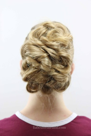 Need an easy updo for prom or a wedding? Try this easy twisted updo hairstyle for all your special occasions. BabesInHairland.com | hair | twists | French braid