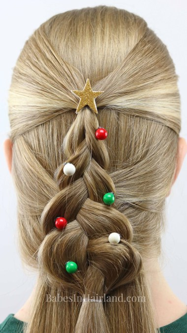 Everyone girl needs a cute hairstyle for Christmas. Try this pretty Mermaid Braid Christmas Tree from BabesInHairland.com. It's perfect for your Christmas plans and school. #hair #hairstyle #Christmashair #Christmastree #Christmashairstyle #mermaidbraid #braid #beauty #frenchbraid #dutchbraid
